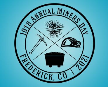 miners day logo with fireworks, hard hat, coal cart and pick axe