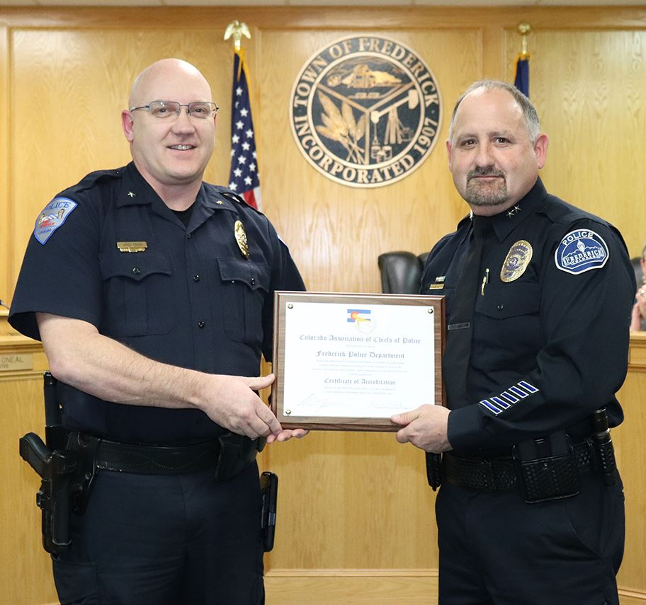 picture of police award at board meeting